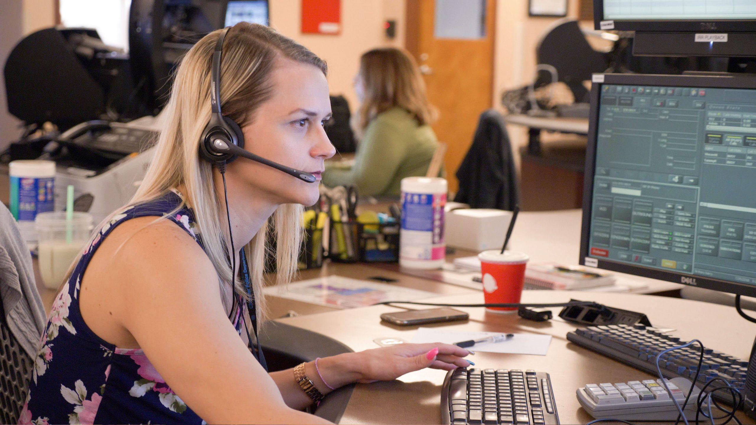 A 911 telecommunicator taking emergency calls